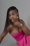 Attractive Black woman in pink evening dress Stock Images