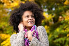 Attractive black woman smiling outdoors in autumn Royalty Free Stock Photography