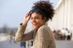 Attractive black woman smiling outdoors Stock Image