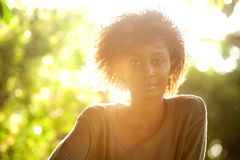 Attractive black woman and sunset. Close up portrait of an attractive black woman and sunset Royalty Free Stock Image