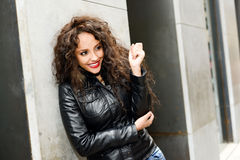 Attractive black woman in urban background wearing leather jacke Royalty Free Stock Photography