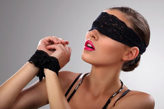 Attractive blindfolded girl close up Stock Photos