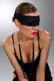 Attractive blindfolded girl sitting close up Stock Images