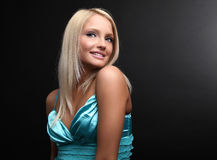 Attractive blond beauty posing in dark background Royalty Free Stock Photo