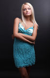 Attractive Blond Beauty Posing In Dark Background Royalty Free Stock Photography