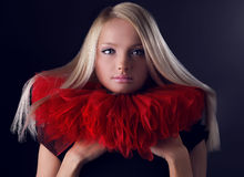 Attractive blond beauty in red theatrical jabot Royalty Free Stock Photos
