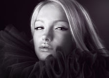 Attractive blond beauty in a theatrical jabot. Royalty Free Stock Images
