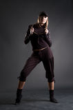 Attractive blond in black clothes dancing Stock Photo