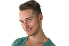 Attractive blond, blue eyed young man smiling Royalty Free Stock Photography