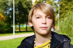 Attractive blond boy in park Royalty Free Stock Photography