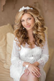 Attractive blond bride wedding portrait. Young woman with long c Stock Photos