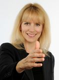Attractive blond business woman offers hand for handshake Stock Photography