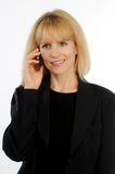 Attractive blond business woman talking on cellular phone Stock Photos