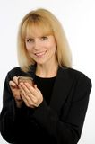 Attractive blond business woman texting on cellular phone Stock Images