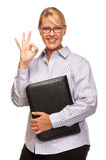Attractive Blond Businesswoman with Okay Hand Sign on White Stock Images