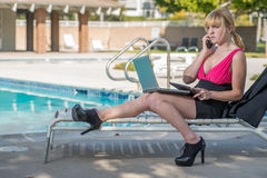 Attractive blond caucasian business woman Stock Photos