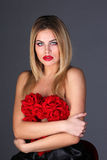 Attractive blond covered of roses Stock Image