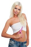 Attractive blond female cutting her clothes Royalty Free Stock Photo