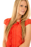 Attractive blond female model wearing a red blouse Royalty Free Stock Image