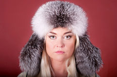 Attractive blond in a fur hat Stock Images