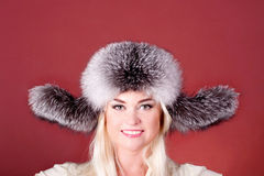 Attractive blond in a fur hat Stock Photo