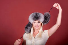 Attractive blond in a fur hat Royalty Free Stock Photo