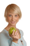 Attractive blond girl with an apple Stock Image
