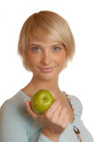 Attractive blond girl with an apple Royalty Free Stock Image