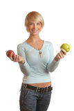 Attractive blond girl with apples Stock Photos