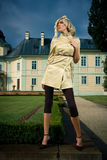 Attractive blond girl in castle park Royalty Free Stock Photography