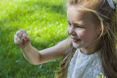Attractive blond girl and dragonfly Stock Images