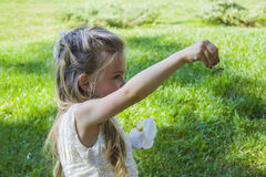 Attractive blond girl and dragonfly Royalty Free Stock Photography