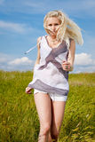 Attractive blond girl on field Royalty Free Stock Photo