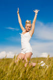 Attractive blond girl on field Stock Image
