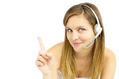 Attractive blond girl with headset shows your text Stock Photos