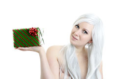 Attractive blond girl holding gift Stock Photos