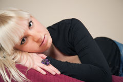 Attractive blond girl lying on bed Royalty Free Stock Photos