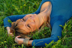 Attractive blond girl lying on grass Royalty Free Stock Photography
