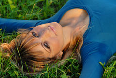 Attractive blond girl lying on grass Royalty Free Stock Photo