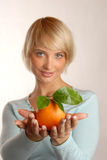 Attractive blond girl with an orange Stock Photos