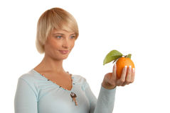 Attractive blond girl with an orange Stock Image