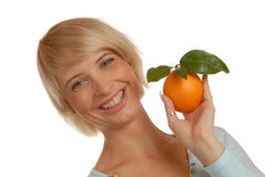 Attractive blond girl with an orange Stock Photography