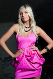 Attractive blond girl in pink. Dress Stock Photography