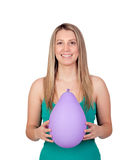 Attractive blond girl with a purple balloon Royalty Free Stock Photo