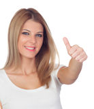 Attractive blond girl saying Ok with focus on the thumb Stock Photography