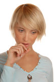 Attractive blond girl thinking Royalty Free Stock Images
