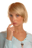 Attractive blond girl thinking Stock Photography