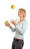 Attractive blond girl with two lemons Royalty Free Stock Photo