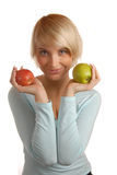 Attractive blond with green and red apple Royalty Free Stock Photo