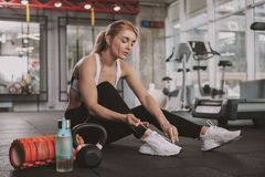Beautiful young fitness woman working out at the gym stock image
